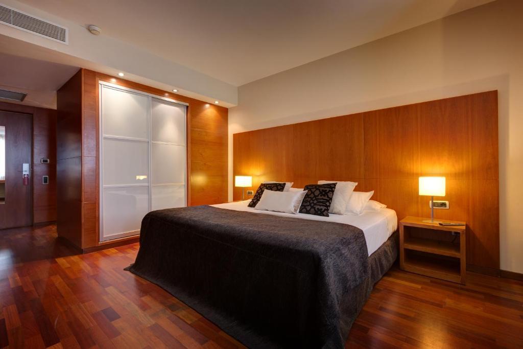 Cama o camas de una habitación en Acevi Villarroel