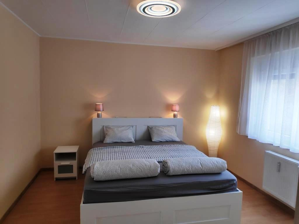 A bed or beds in a room at Kölcsey Apartman