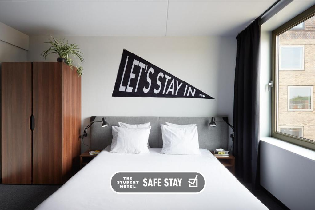A bed or beds in a room at The Student Hotel Groningen