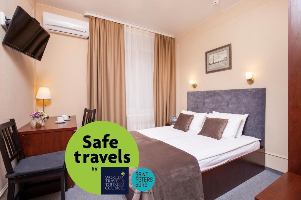 Кровать или кровати в номере Отель на Моховой