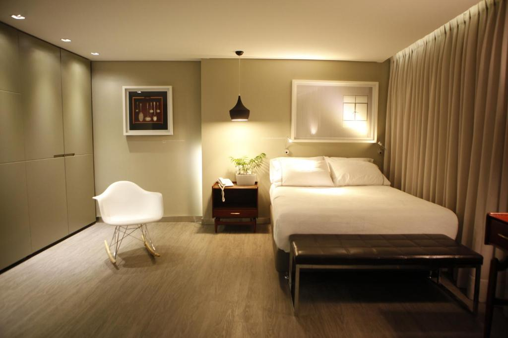 A bed or beds in a room at The Grace Hotel