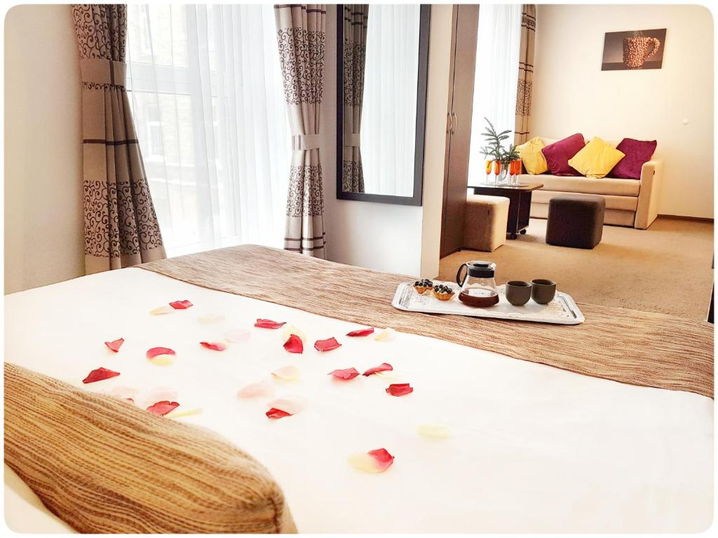 A bed or beds in a room at Vivulskio Apart-Hotel