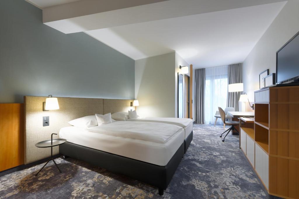 Кровать или кровати в номере Hotel am Kloster