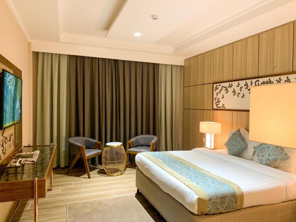 Cama ou camas em um quarto em Midan Hotel