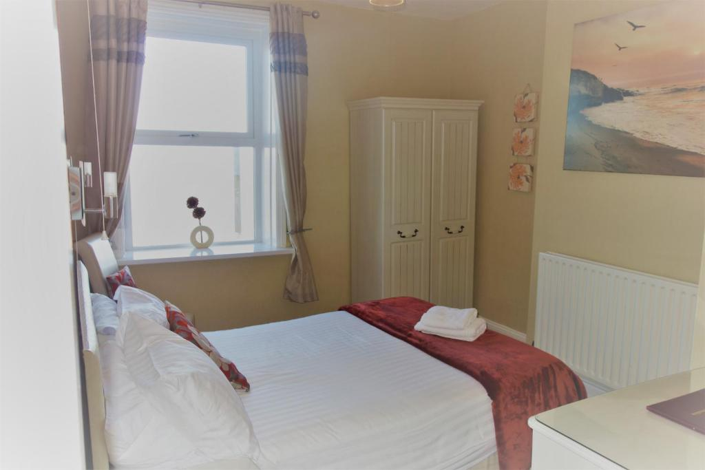 A bed or beds in a room at The Berkeley Morecambe