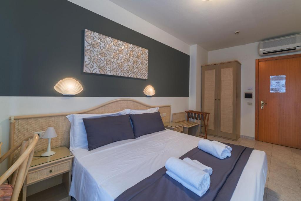 Postel nebo postele na pokoji v ubytování Hotel Airone