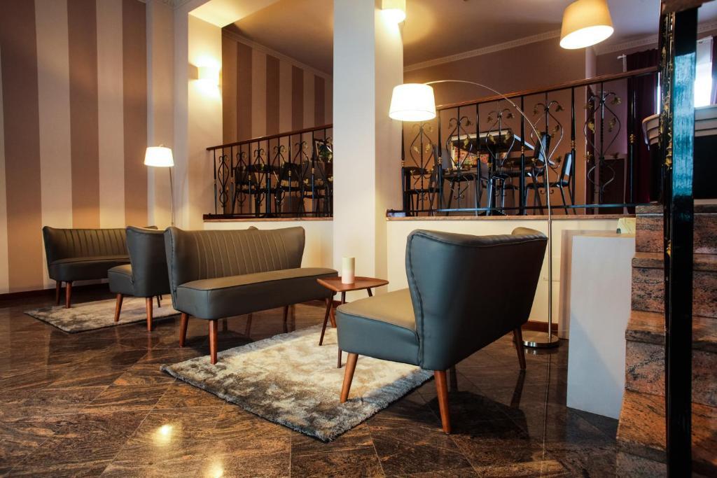 The lobby or reception area at Hotel di Porta Romana
