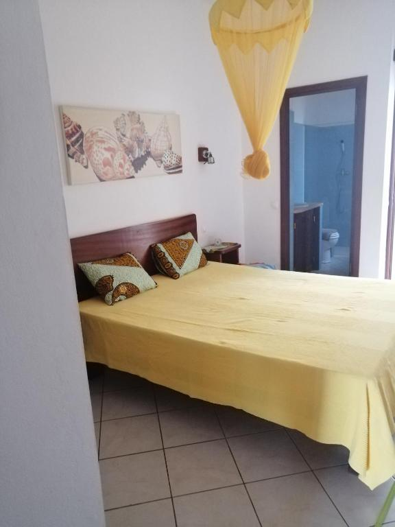 A bed or beds in a room at Casa Mar Doce