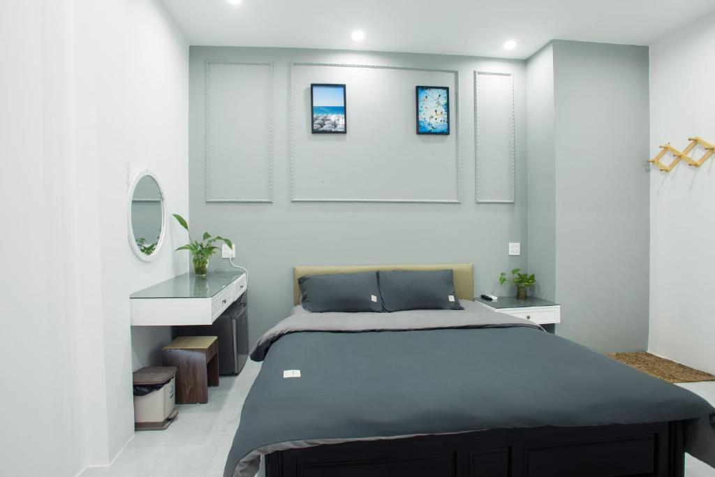 A bed or beds in a room at Lalaland Hostel