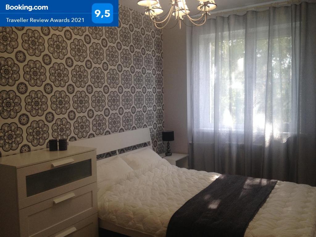 Кровать или кровати в номере Apartments on Gogolya