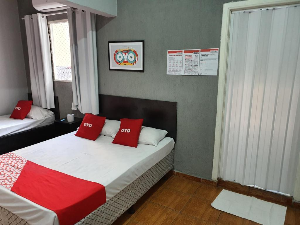 A bed or beds in a room at Hotel Mogi