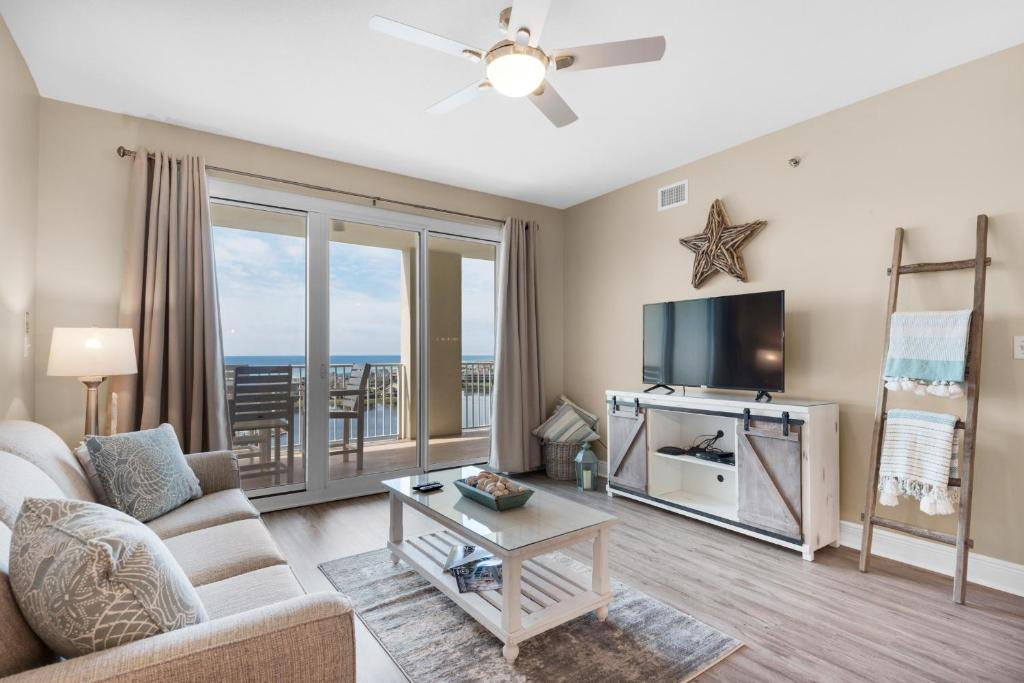 A seating area at Ariel Dunes II 1202 by RealJoy Vacations