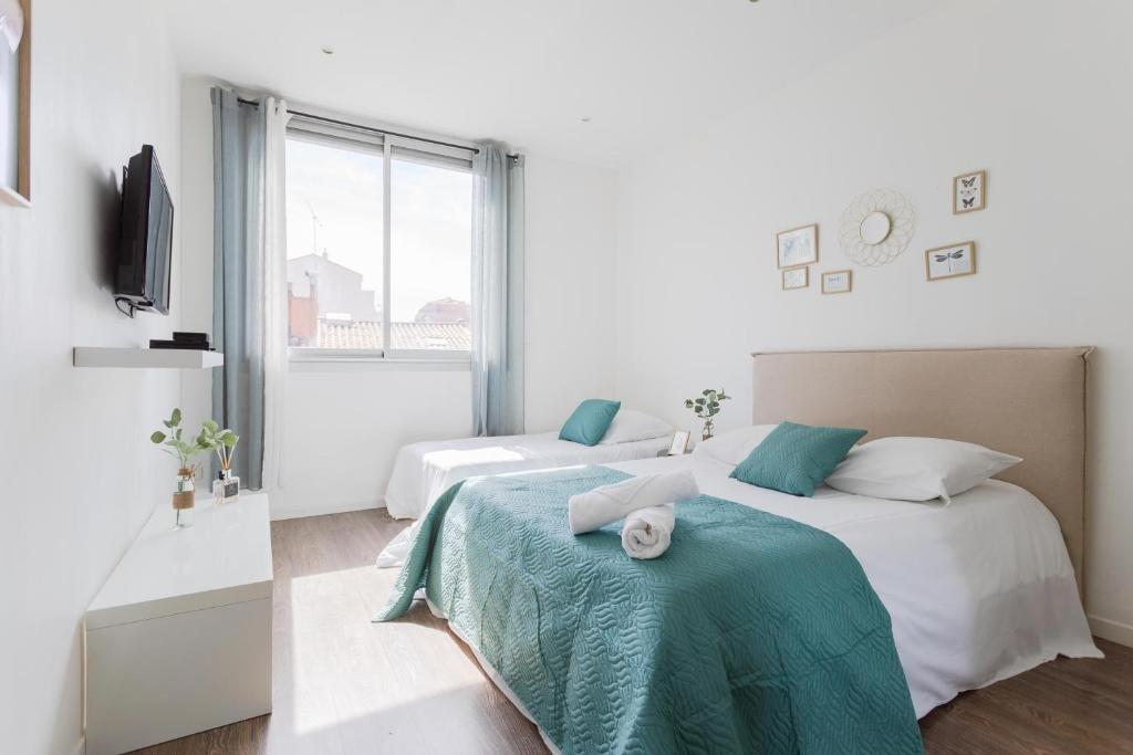 A bed or beds in a room at Appartements Marseille Centre Terrasse