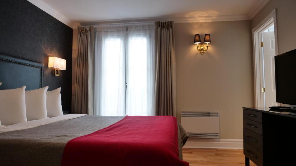 Кровать или кровати в номере Hotel Bonaparte