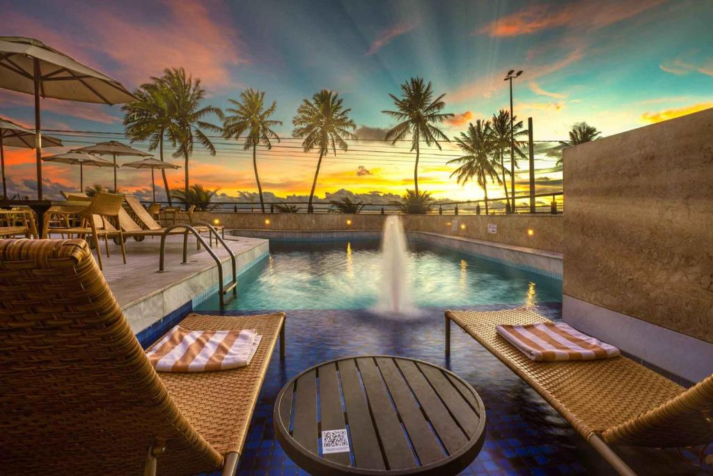 The swimming pool at or near Hardman Praia Hotel