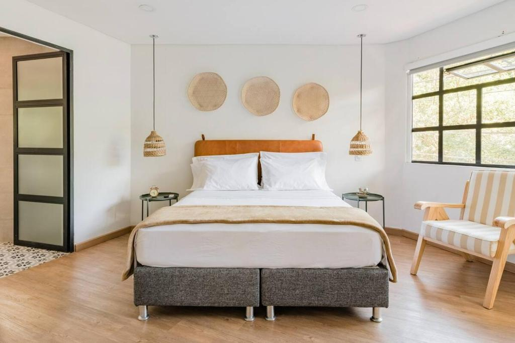 A bed or beds in a room at 574 Hotel