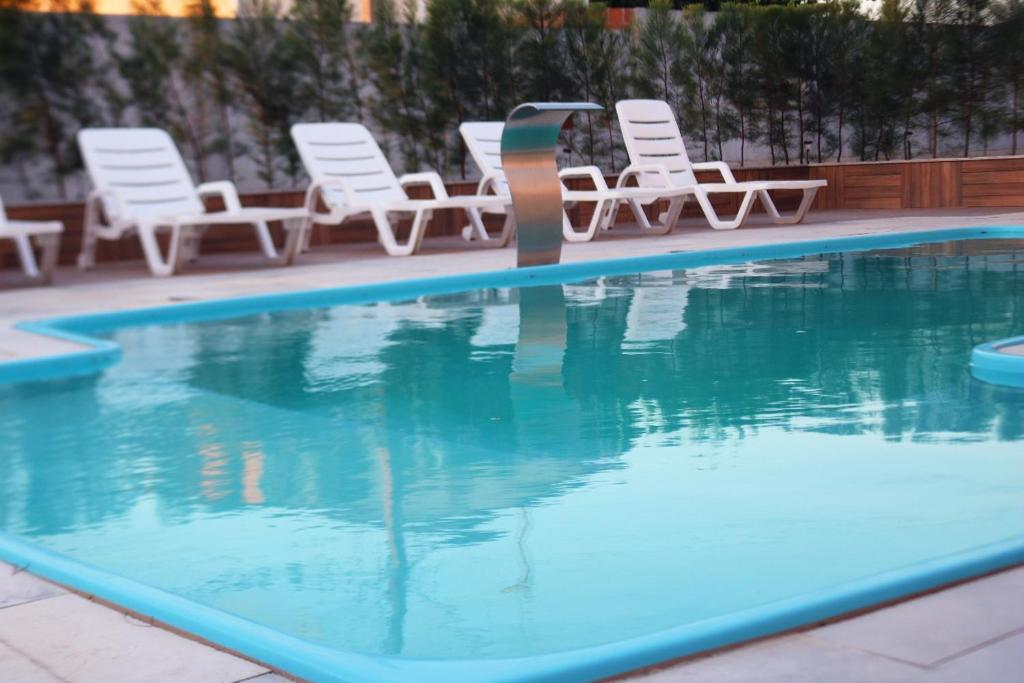 The swimming pool at or near Dunen Hotel
