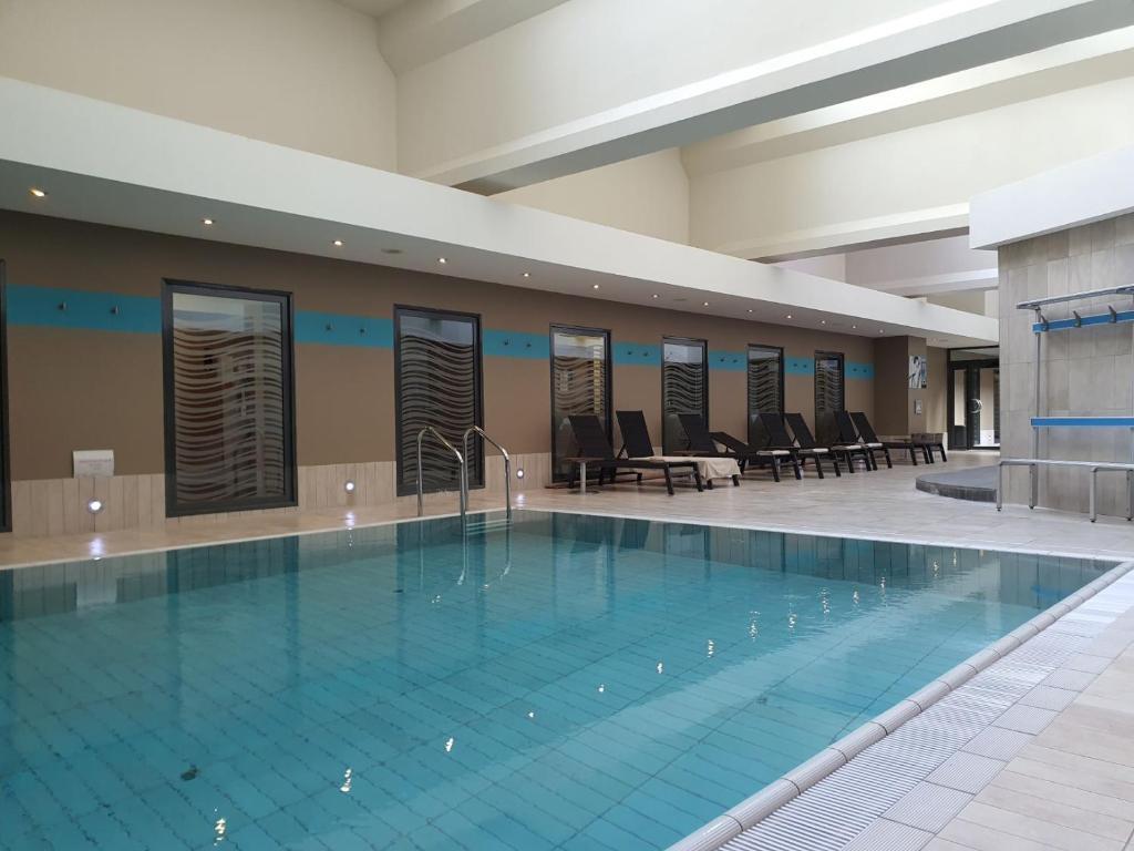 The swimming pool at or near Hotel Spa Le Pasino