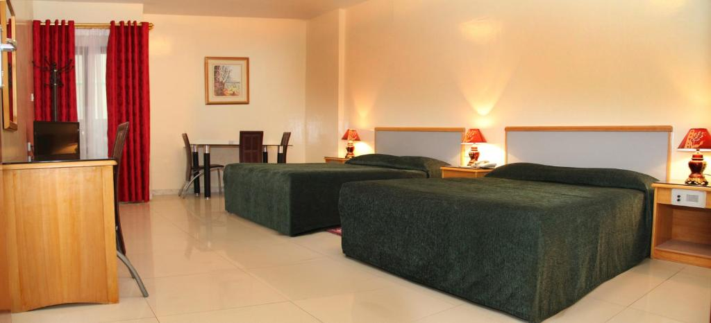 A bed or beds in a room at Al Buhaira Hotel Apartment