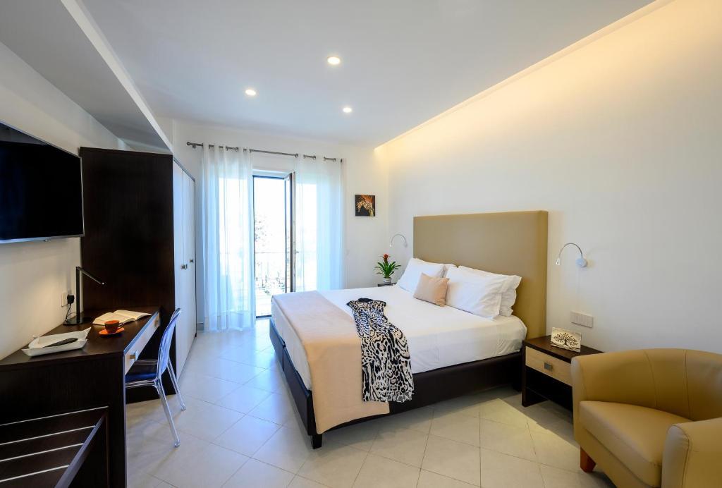 TV o dispositivi per l'intrattenimento presso Angiolina Apartments