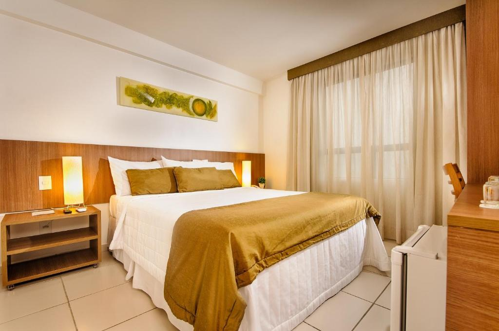 A bed or beds in a room at Villa Park Hotel