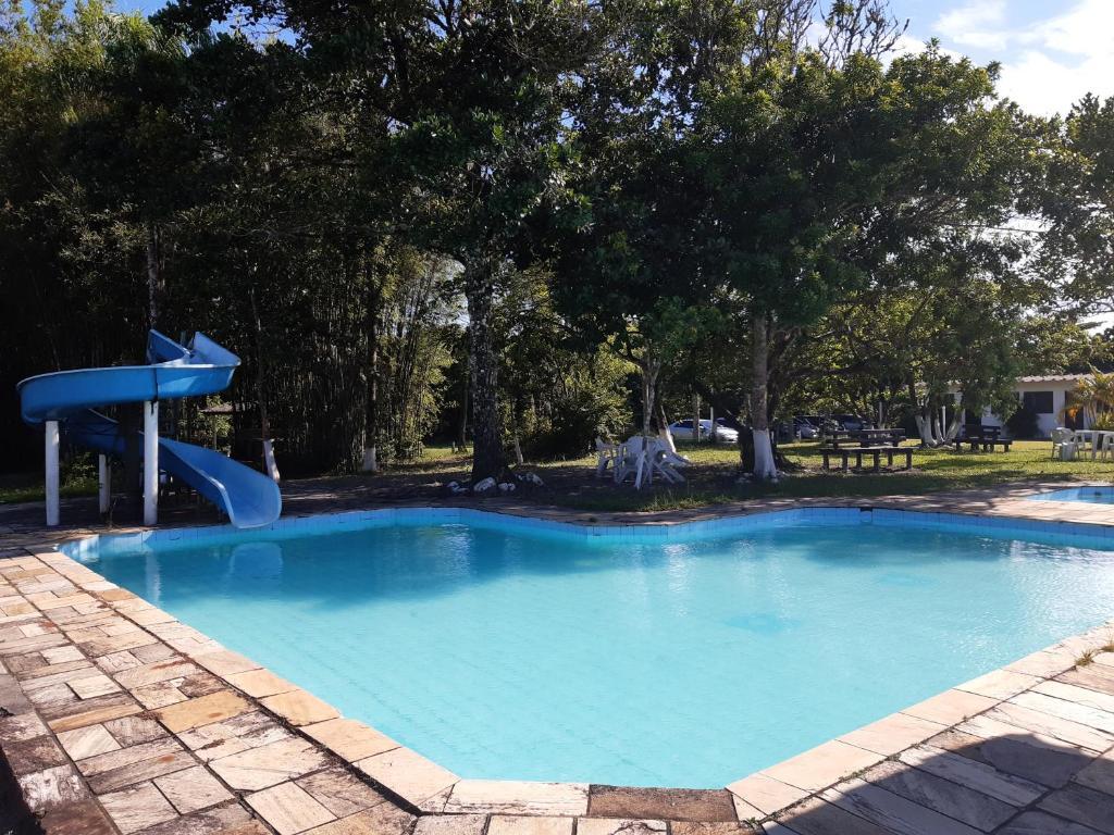 The swimming pool at or near Samburá Chalés