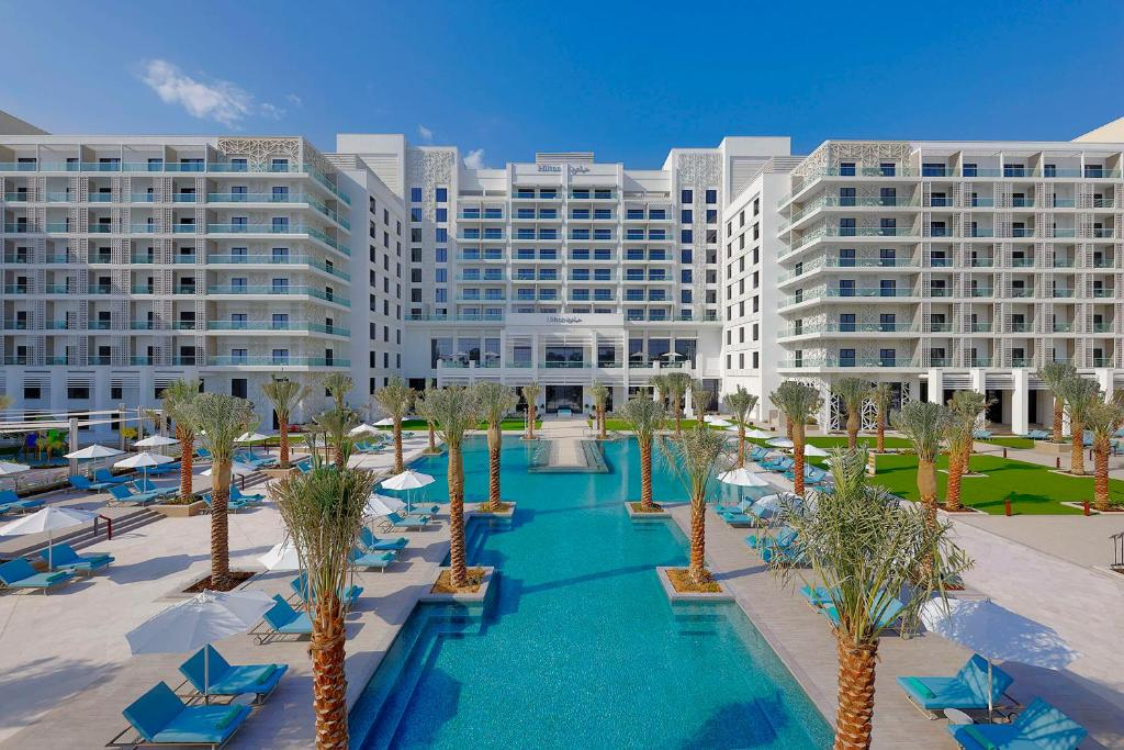 The swimming pool at or near Hilton Abu Dhabi Yas Island
