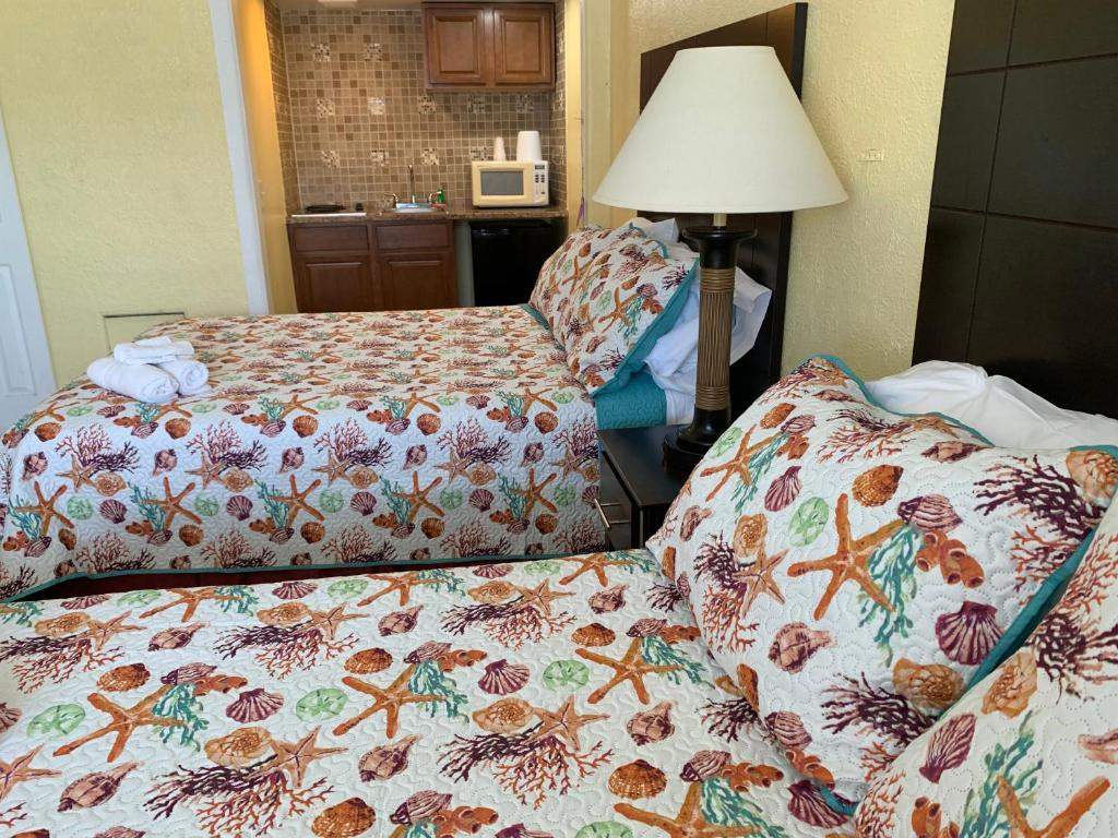 A bed or beds in a room at Sandy Shores Resort