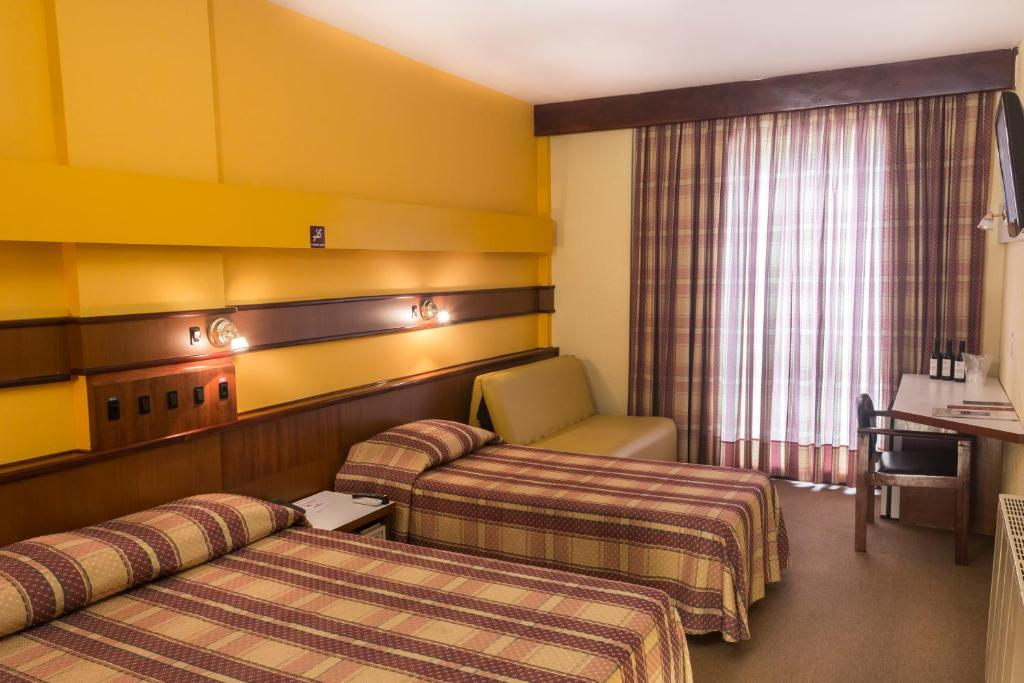 A bed or beds in a room at Hotel Vinocap