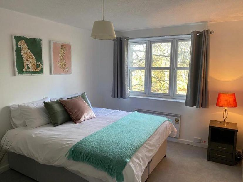 A bed or beds in a room at Farriers Court