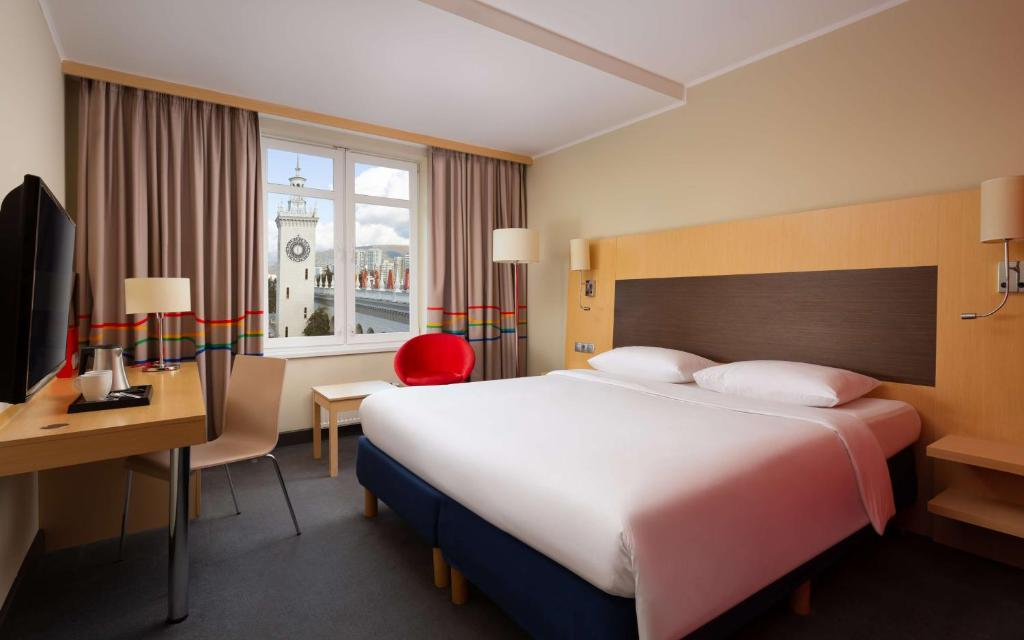 A bed or beds in a room at Park Inn by Radisson Sochi City Centre