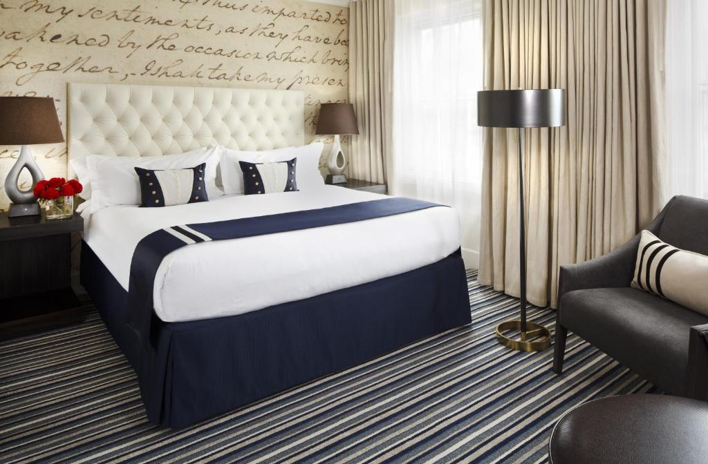 A bed or beds in a room at Kimpton George Hotel, an IHG Hotel