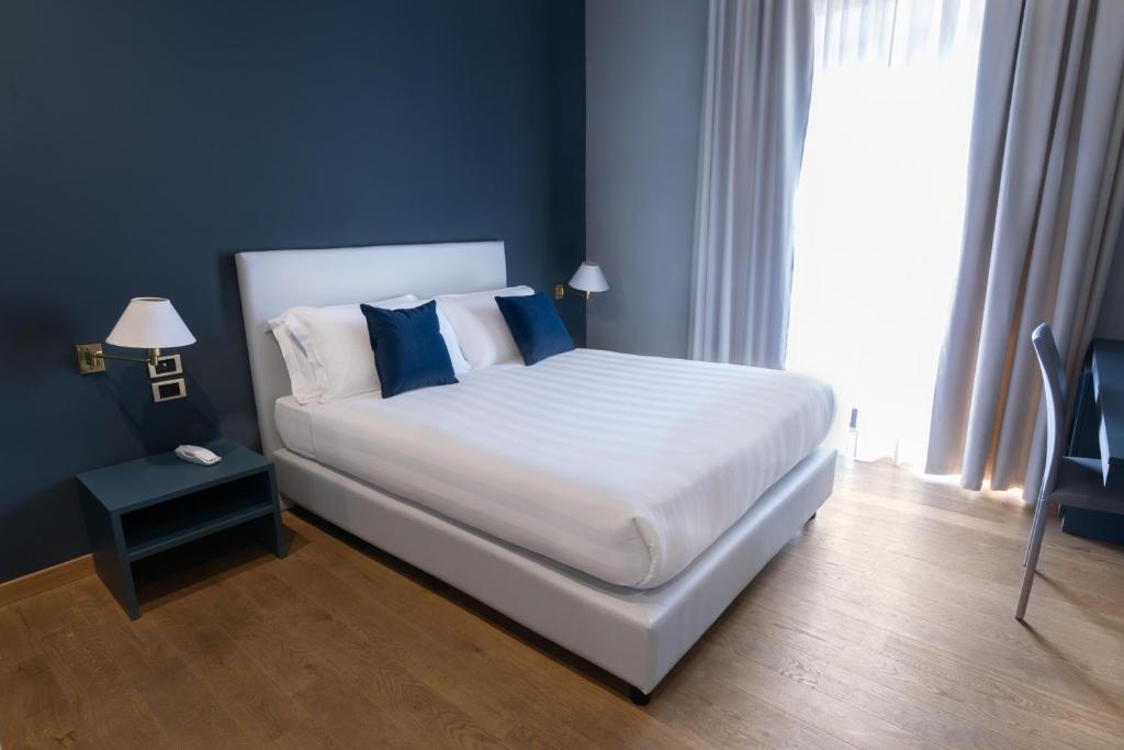 Кровать или кровати в номере Hotel Enzo