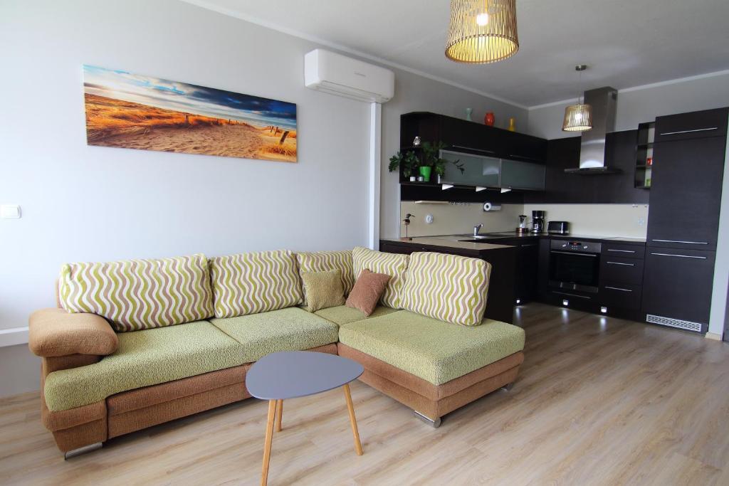 A seating area at Apartamenty Świnoujście - Apartament Nad Kanalem