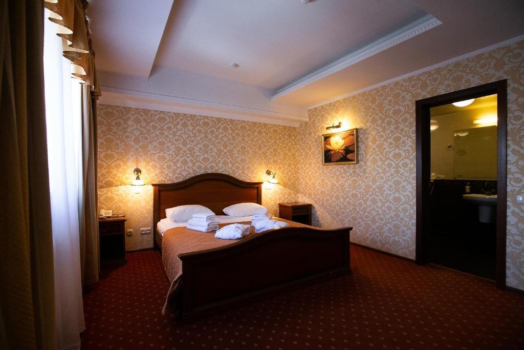 Кровать или кровати в номере Немчиновка Парк