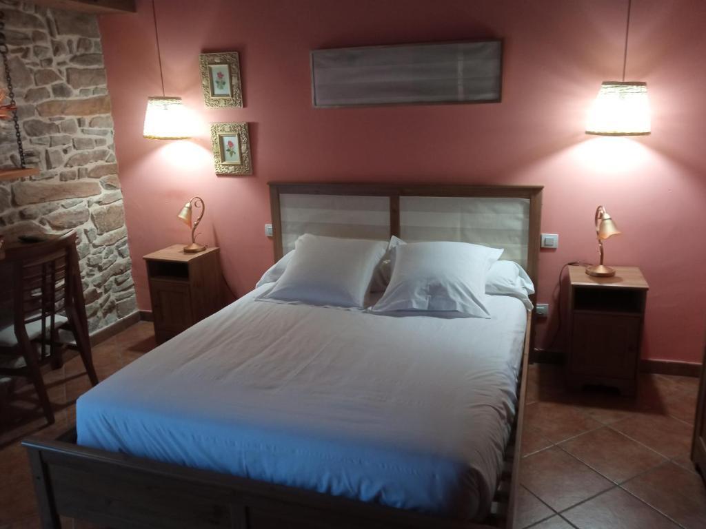 Cama o camas de una habitación en Hotel rural casa la Juana