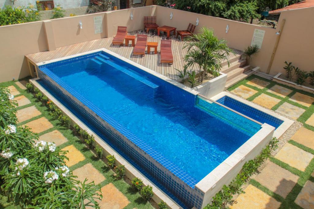 A view of the pool at Villa das Palmeiras or nearby