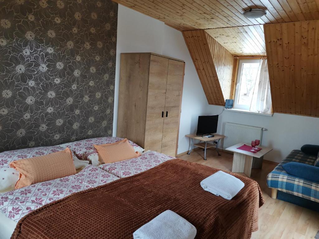 Posteľ alebo postele v izbe v ubytovaní A1 Štart