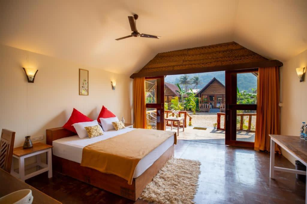 A bed or beds in a room at Royal Agonda
