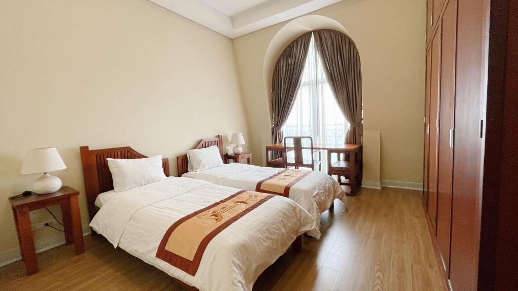 Cama o camas de una habitación en Pacific Place Serviced Apartment