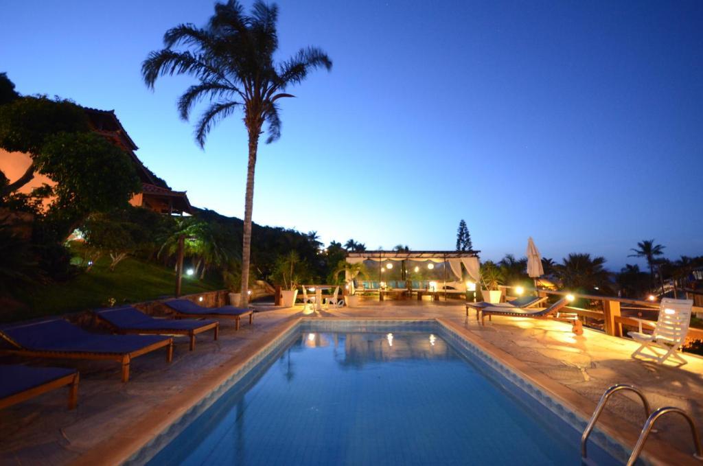 The swimming pool at or near Aguazul Pousada Buzios