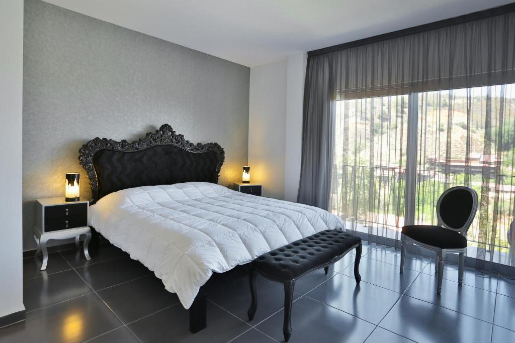 A bed or beds in a room at Crystal Hotel