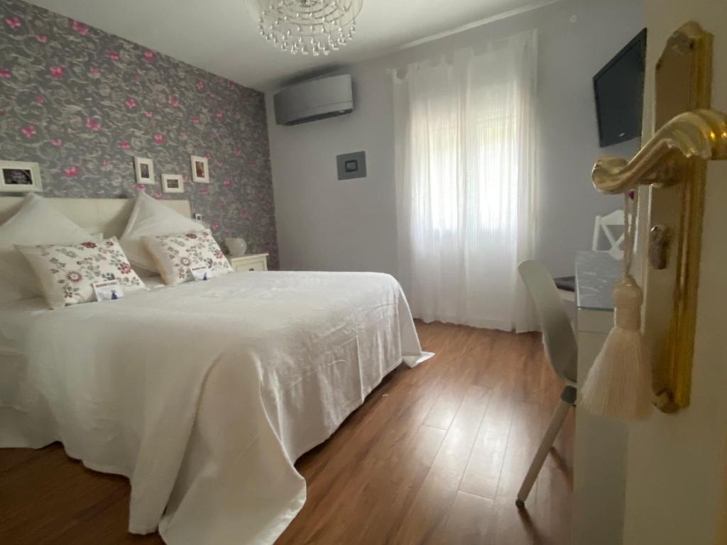 A bed or beds in a room at Apartamento La Biblioteca en Cuenca