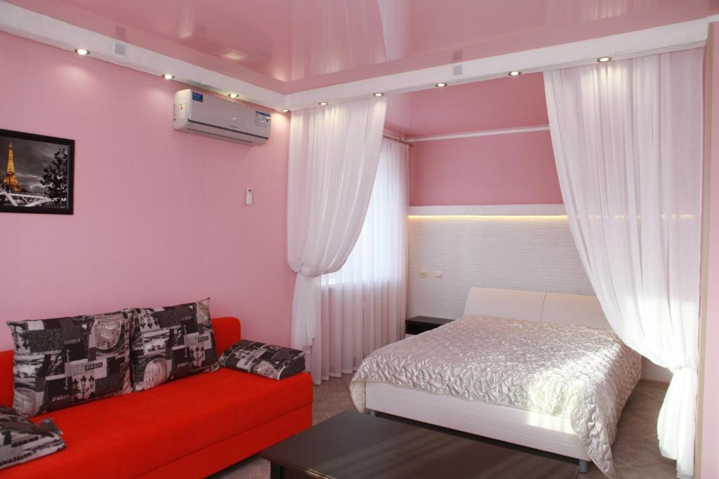 Кровать или кровати в номере Апартаменты в Липецке