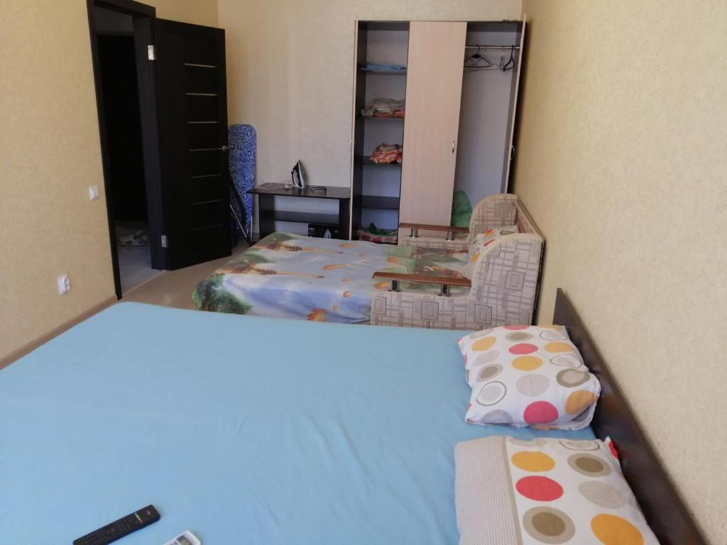 Кровать или кровати в номере ЛюксКвартира#15