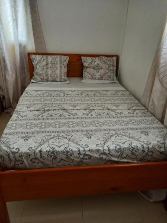 A bed or beds in a room at Le Mastro Chambre d'hôtes