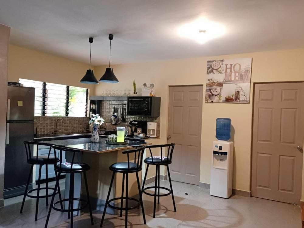 A kitchen or kitchenette at House Rental Banaba Tree