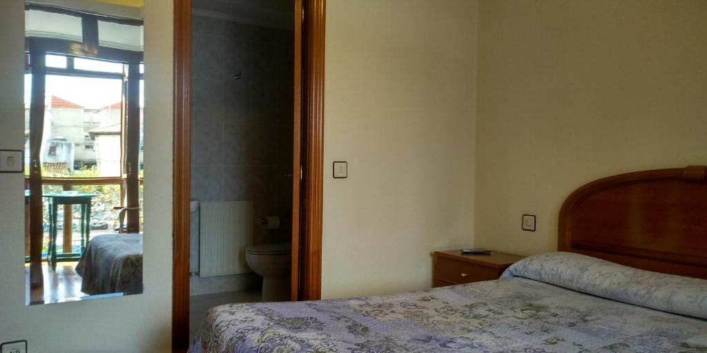 A bed or beds in a room at HOSTAL SANCHO GARCIA