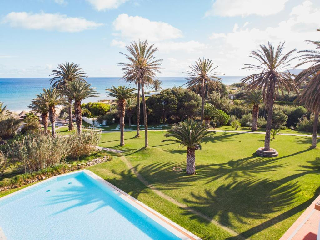 A view of the pool at Hotel Porto Santo & Spa or nearby
