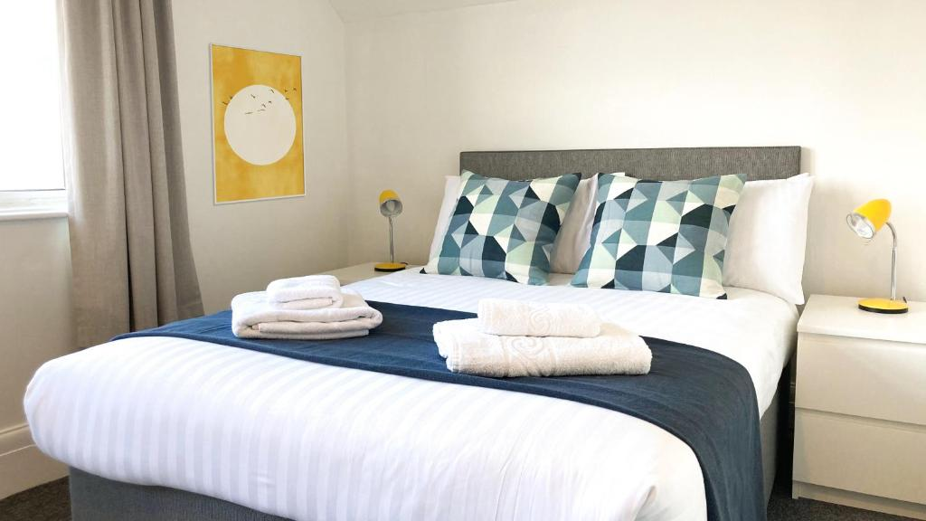 A bed or beds in a room at Twenty9